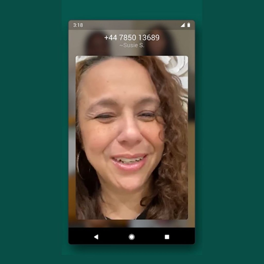 A screenshot a woman in a group video call on WhatsApp