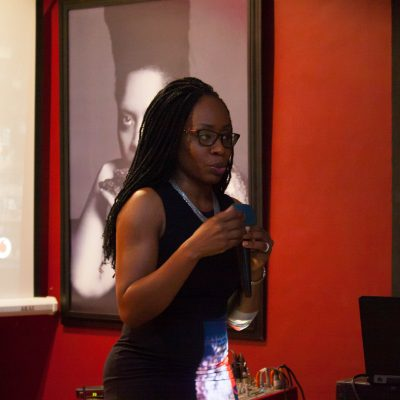 Florence Ohene holding a microphone